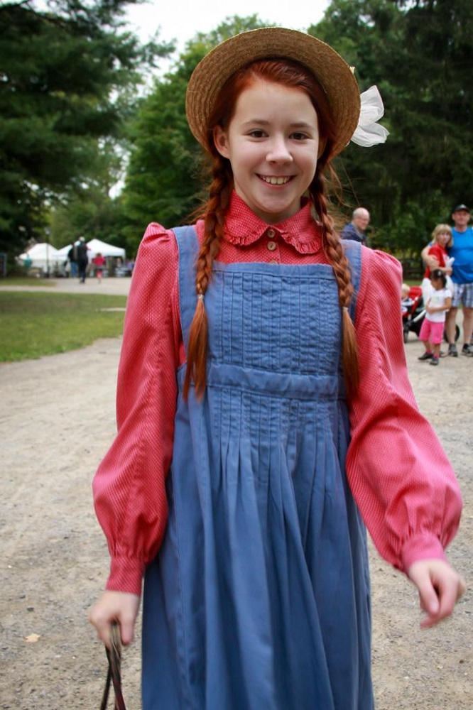 Teen girl dressed as Anne of Green Gables at the Telling Tales Festival