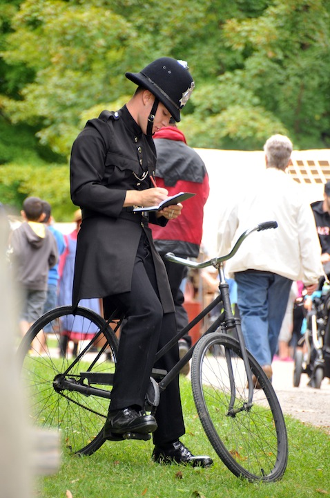 Photo of a man dressed as an old fashioned police officer at the Telling Tales Festival