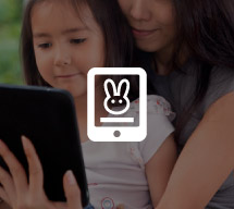 Girl and mother reading from an eReader