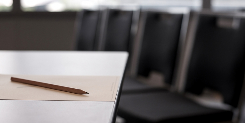 Closeup of chairs around a meeting room table