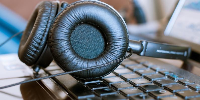 Closeup of headphones resting on a laptop