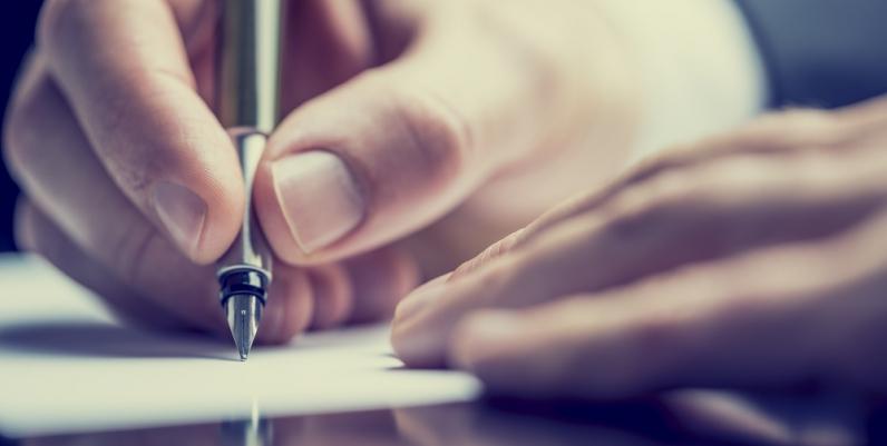 Closeup of a man writing
