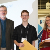 photo of a teenage boy who have received an award from two adults