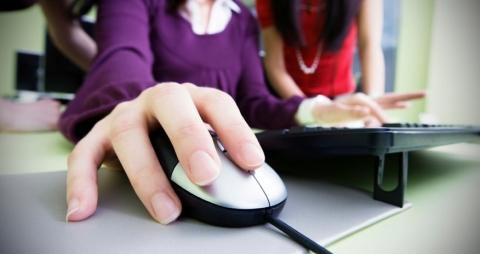 A pair of teen girls using a computer