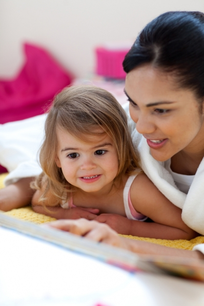 Mother reading with young daughter
